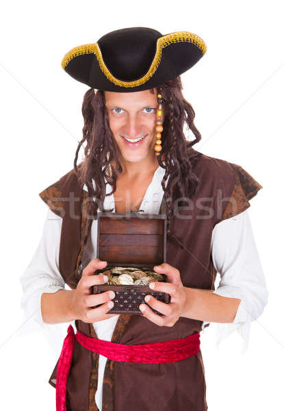 Pirate Holding Treasure Box Stock photo © AndreyPopov