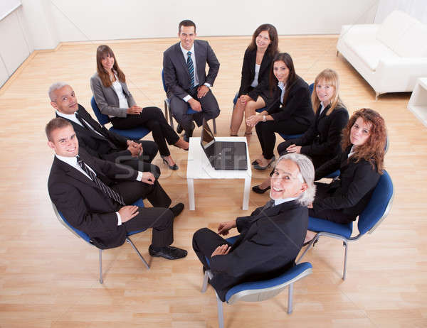 Group Of Business People Sitting On Chairs Stock photo © AndreyPopov