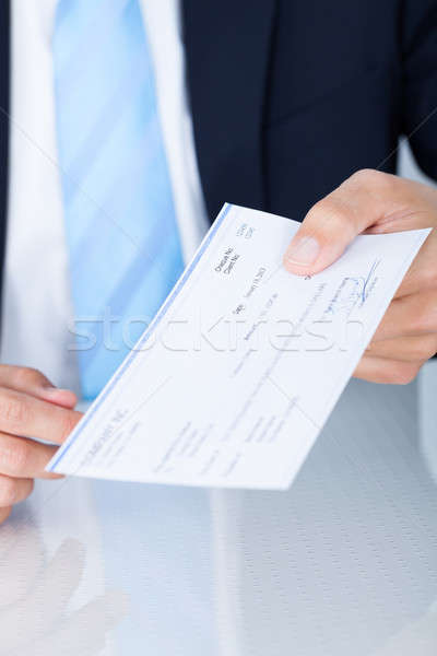 Businessman Holding Cheque Stock photo © AndreyPopov