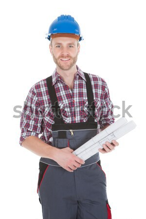 Stock photo: Happy Young Male Worker Holding Contract Form