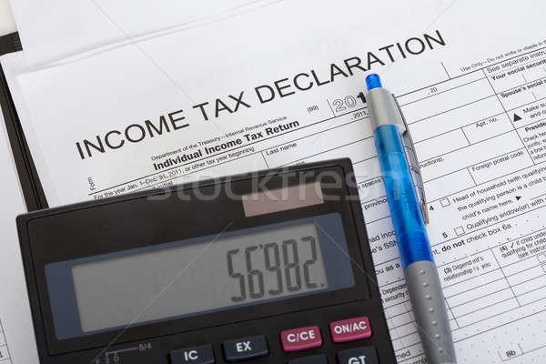 Jövedelem adó nyilatkozat közelkép számológép toll Stock fotó © AndreyPopov