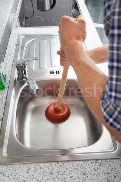 Man With Plunger Stock photo © AndreyPopov