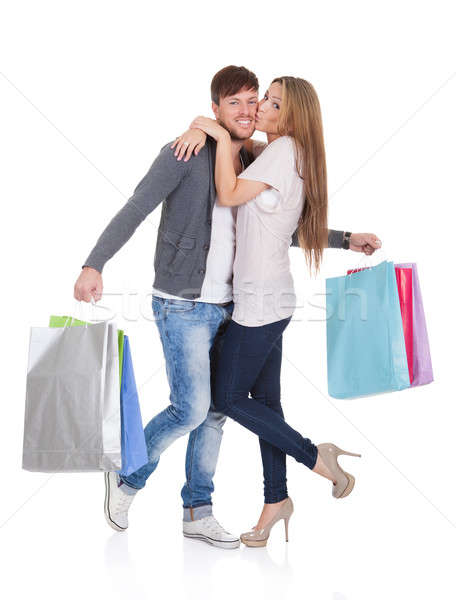 Guy and gal brings shopping bags Stock photo © AndreyPopov