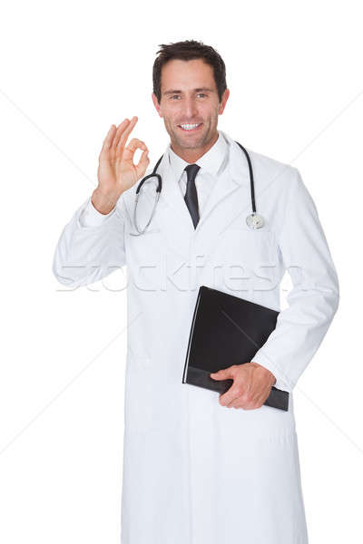 Portrait of friendly doctor making Okay gesture Stock photo © AndreyPopov