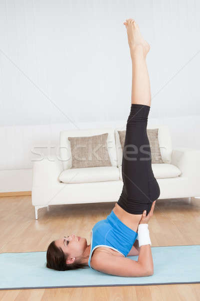 Woman doing a shoulder stand Stock photo © AndreyPopov