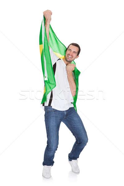 Portret szczęśliwy człowiek banderą odizolowany Zdjęcia stock © AndreyPopov