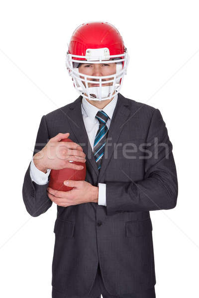Konkurencyjny biznesmen gry amerykański piłka nożna odizolowany Zdjęcia stock © AndreyPopov