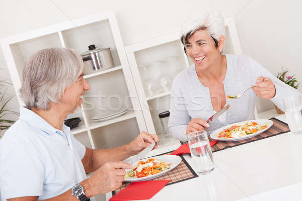 Senior couple eating a meal Stock photo © AndreyPopov