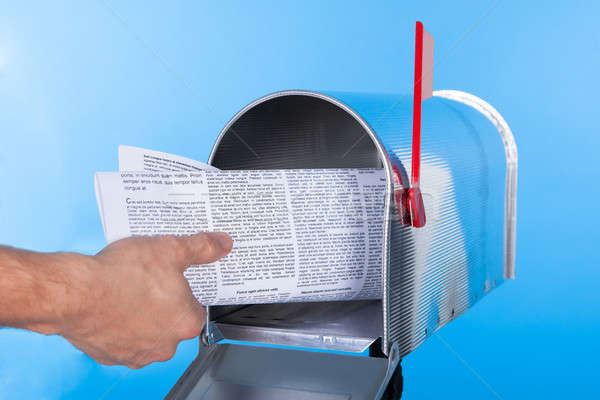 Man removing a newspaper from his mailbox Stock photo © AndreyPopov