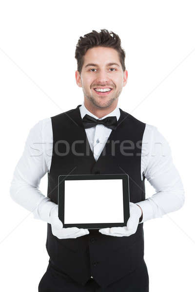 Butler Displaying Digital Tablet Stock photo © AndreyPopov