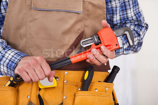 Repairman Holding Pipe Wrench Stock photo © AndreyPopov