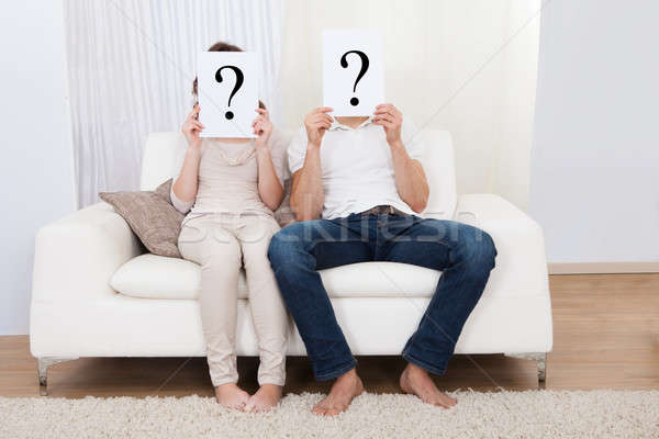Couple with question marks Stock photo © AndreyPopov