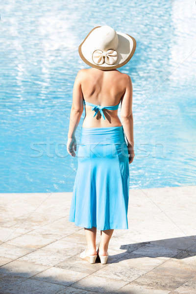 Rear view of woman standing at poolside Stock photo © AndreyPopov