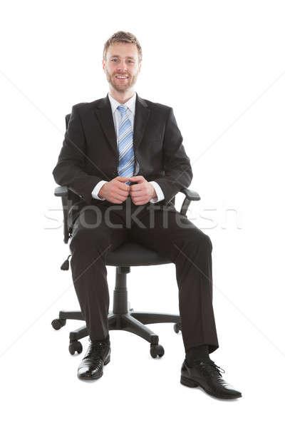 Stok fotoğraf: Işadamı · oturma · ofis · koltuğu · tam · uzunlukta · portre · beyaz