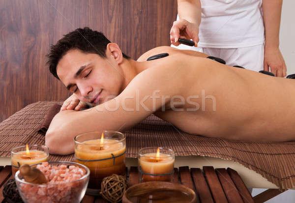 Man Receiving Lastone Therapy In Spa Stock photo © AndreyPopov