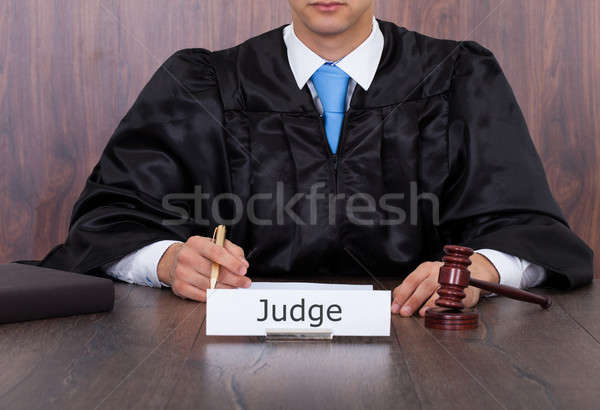 Judge With Mallet Sitting At Desk Stock photo © AndreyPopov