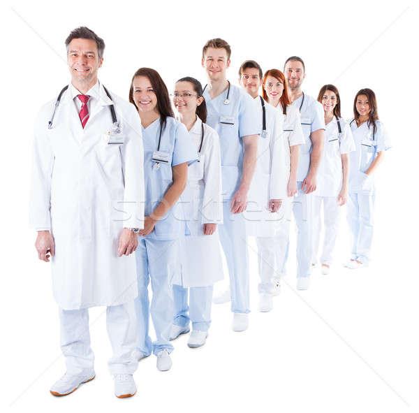 Długo line uśmiechnięty lekarzy kolejka Zdjęcia stock © AndreyPopov