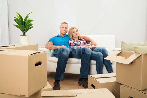 Couple In New Home Relaxing On Couch Stock photo © AndreyPopov