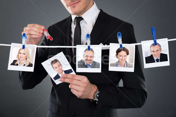 Businessman Selecting Candidate From Clothesline Stock photo © AndreyPopov