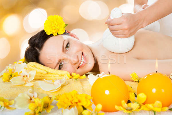 Beautiful Woman Receiving Massage With Herbal Compress Balls Stock photo © AndreyPopov