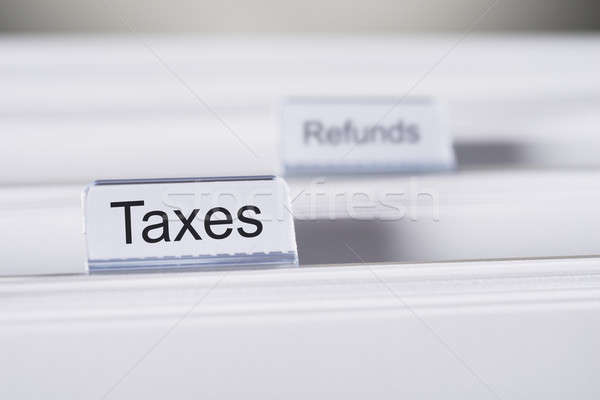 Taxes And Refunds Tabs On Folders Stock photo © AndreyPopov