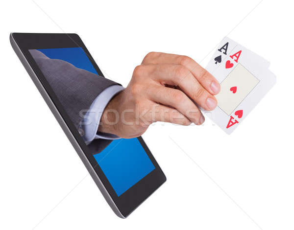 Hand Holding Ace Cards Coming From Tablet Stock photo © AndreyPopov