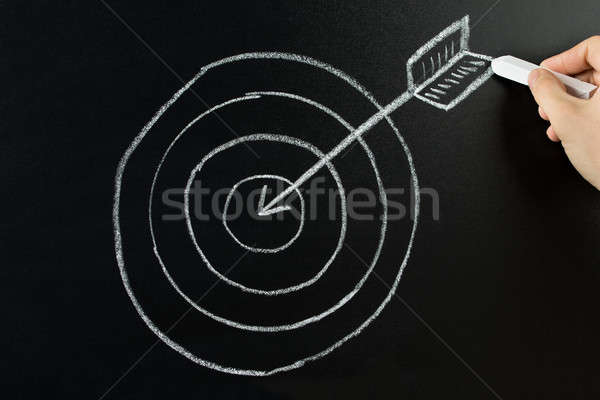 Person Drawing Dart And Arrow On Blackboard Stock photo © AndreyPopov