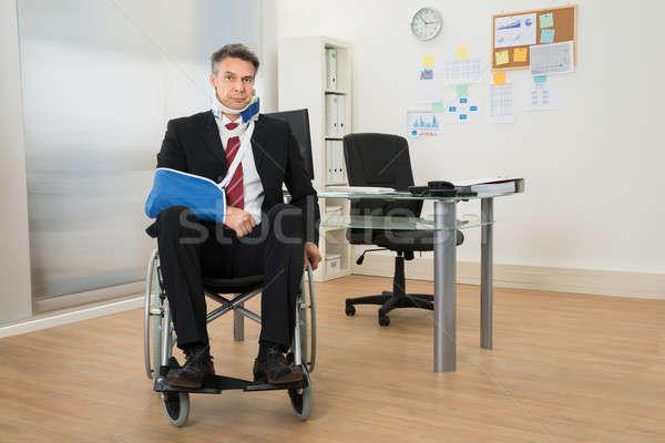 Handicapped Businessman Sitting On Wheelchair Stock photo © AndreyPopov