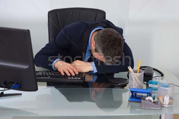 Tired Businessman At Desk Stock photo © AndreyPopov