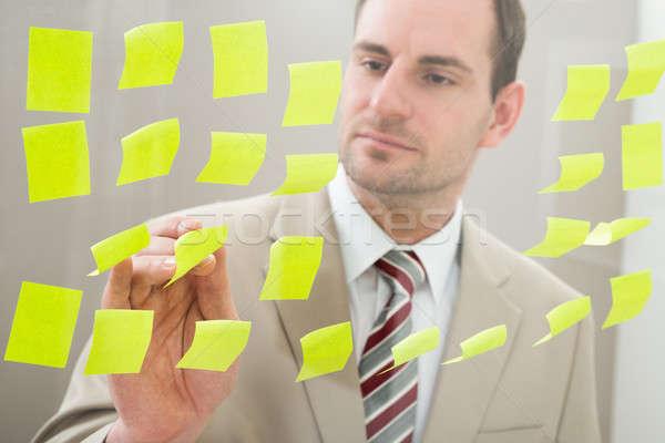 Stock photo: Businessman Looking At Adhesive Notes