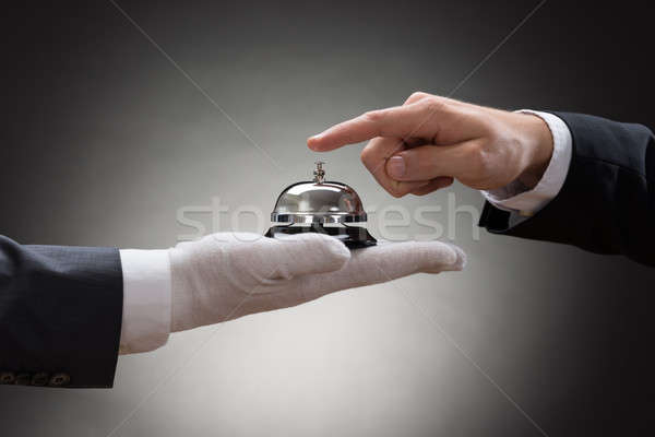 Close-up Of A Person's Hand Ringing Service Bell Stock photo © AndreyPopov