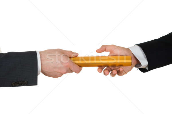 Two Hands Passing A Golden Relay Baton Stock photo © AndreyPopov