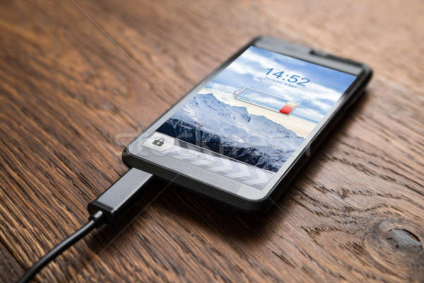 Mobile Phone On Charge Stock photo © AndreyPopov