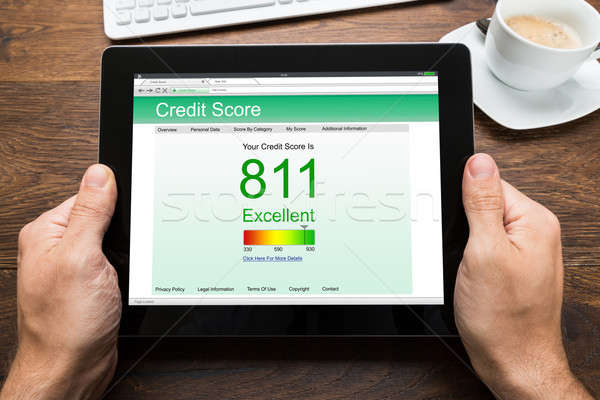 Person Hands With Digital Tablet Showing Credit Score Stock photo © AndreyPopov