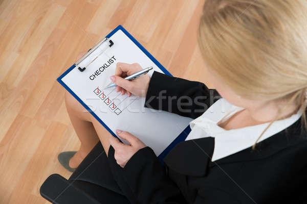 Businesswoman Marking Checklist Stock photo © AndreyPopov