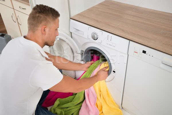 Man Loading Towels Into The Washing Machine Stock photo © AndreyPopov
