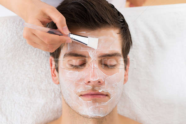 Stock photo: Therapist Applying Face Mask To Man