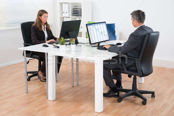 Two Businesspeople In Office Stock photo © AndreyPopov