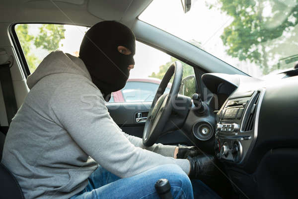 Thief With Mask Sitting In A Car Stock photo © AndreyPopov