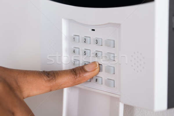 Person's Hand Entering Code In Security System Stock photo © AndreyPopov