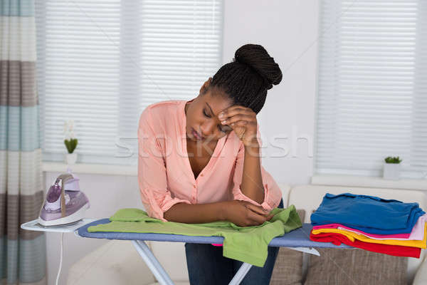 Woman Exhausted While Ironing Clothes Stock photo © AndreyPopov