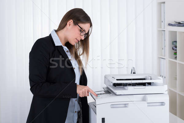 Businesswoman Using Copy Machine Stock photo © AndreyPopov