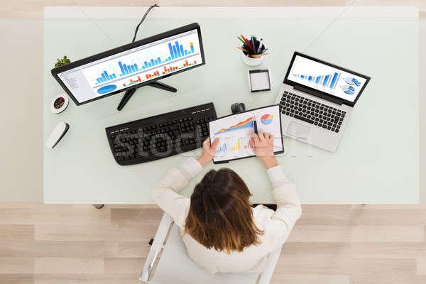 Businesswoman Analyzing Financial Graphs Stock photo © AndreyPopov