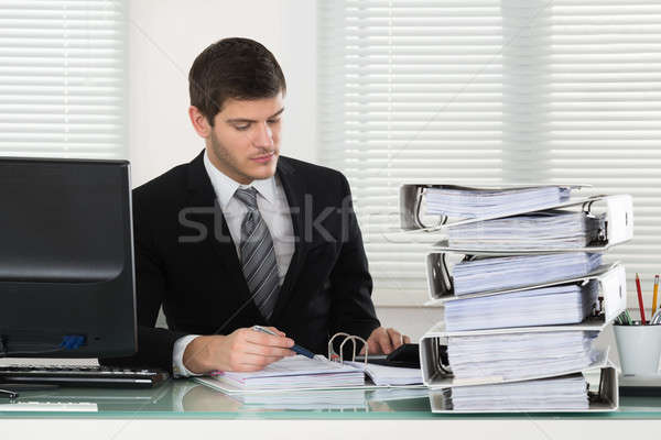 Businessman Calculating Invoice Stock photo © AndreyPopov