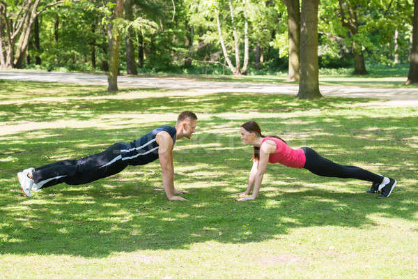 Stock photo: Couple Doing Push-ups In Park