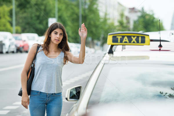 Woman Calling For Taxi On Street Stock photo © AndreyPopov
