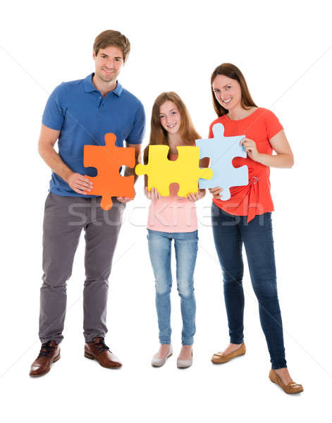 Család tart kirakós játék darabok portré boldog család Stock fotó © AndreyPopov