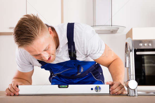 Plumber Measuring Level Of A Sink Stock photo © AndreyPopov
