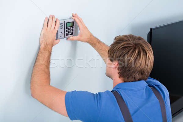 Repairman Installing Security System Stock photo © AndreyPopov