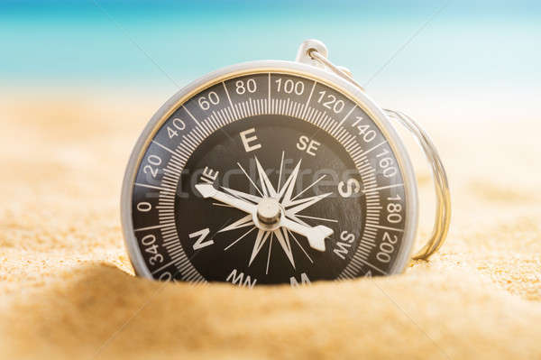 Compass On Sandy Beach Stock photo © AndreyPopov